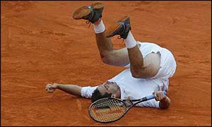 Albert Costa tumbles to the ground in joy after winning the French Open