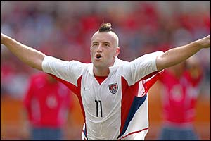 USA midfielder Clint Mathis celebrates scoring the opening goal against South Korea