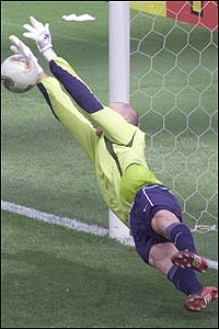 The USA's keeper Brad Friedel saves a penalty struck by South Korea's Lee Eul-Yong