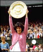 Virginia Wade lifts the Wimbledon trophy