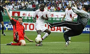 Marc Wilmots (left) puts Belgium in front