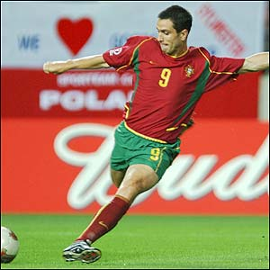 Portugal's Pauleta shoots to score in the 14th minute against Poland