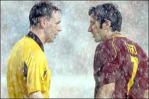Referee Hugh Dallas of Scotland speaks to Portugal's striker Luis Figo