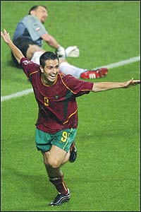 Portugal's Pauleta runs past Polish keeper Jerzy Dudek after scoring his hat-trick