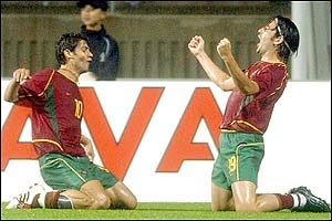 Portugal's Rui Costa celebrates with team-mate Nuno Capucho after scoring Portugal's fourth goal