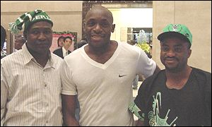 Nigeria goalkeeper Ike Shoronmu poses with fans