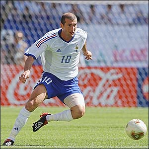 France's Zinedine Zidane looks to pass the ball
