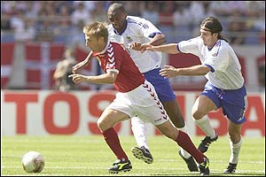Denmark's Martin Jorgensen is pursued by Patrick Vieira and Vincent Candela