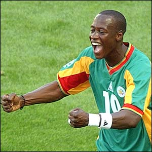 Senegal's Khalilou Fadiga reacts after scoring a penalty against Uruguay