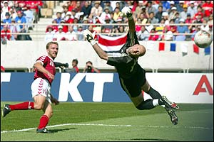 Denmark's Dennis Romedahl sweeps the ball past Fabien Barthez to score for Denmark