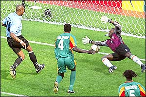 Uruguay's Richard Morales shoots the ball past Senegal's goalkeeper Tony Sylva