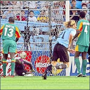 Uruguay's Diego Forlan puts the ball past Senegal's goalkeeper Tony Sylva
