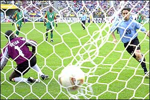 Uruguay's Alvaro Recoba scores a penalty past Senegal's goalkeeper Tony Sylva