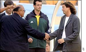 Uruguay coach Victor Pua shakes hands with his opposite number Bruno Metsu