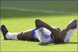 Sylvain Wiltord of France puts his head in his hands at the final whistle