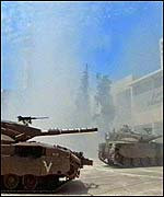 Isreali troops and tanks set the stage for one of the most dramatic sieges in modern history