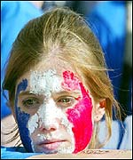 A young fan looks on forlornly as France lose 2-0 to Denmark
