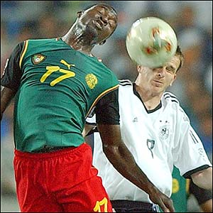 Cameroon's Marc-Vivien Foe and Germany's Dietmar Hamann challenge for a high ball