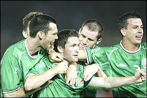 Robbie Keane is hugged by his team-mates after scoring the opening goal against Saudi Arabia