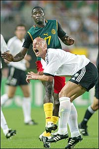 Germany's Carsten Jancker is caught late by Germany's Carsten Jancker