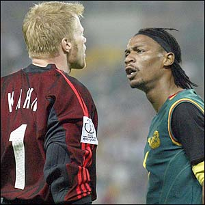 Germany's Oliver Kahn and Rigobert Song argue