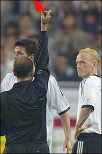 Referee Antonio Lopez Nieto from Spain waves the red card at Germany's Carsten Ramelow