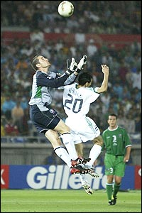 Ireland's goalkeeper Shay Given clashes with Al-Hassan Al-Yami
