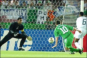Irish forward Robbie Keane scores a goal during the Group E first round match Saudi Arabia