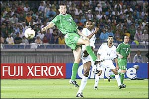 Gary Breen of Ireland scores an important second goal after 61 minutes against Saudi Arabia