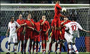 The Belgium wall fails to keep out Raouf Bouzaiene's free-kick