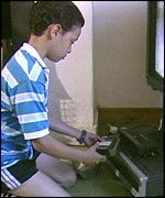 A child setting a video recorder