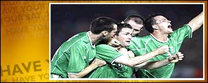 Robbie Keane (middle) is mobbed after scoring Ireland's first goal