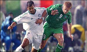 Damien Duff battles for possession