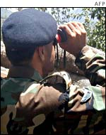Pakistan Army officer watches Indian troop movements