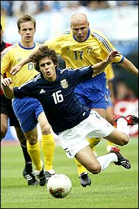 Sweden are up against it as Magnus Svensson brings down Argentina's Pablo Aimar