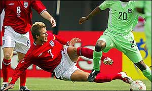 England captain David Beckham rides a tackle