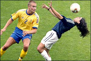 Olof Mellberg watches as Juan Pablo Sorin chests the ball for Argentina