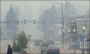 Smoke from forest fires fills the air in Woodland Park on the edge of Colorado caused street lights to come on Sunday