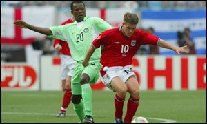 Nigeria's James Obiorah marking England's Micheal Owen