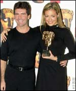 Simon Cowell and Cat Deeley