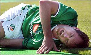 Jason McAteer in agony after picking up knee injury in pre-World Cup match