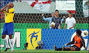 Raul Guerron (left) and Jose Cevallos are dismayed by Gerardo Torrado's winning goal for Mexico