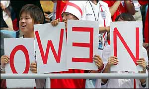 England-supporting Japanese fans hold up placards spelling out the name of Michael Owen