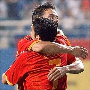 Raul celebrates his early goal for Spain