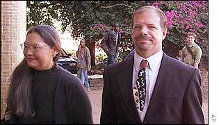 Andrew Meldrum, with his wife, Dolores, arriving at court
