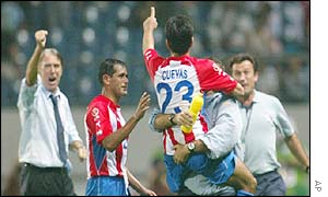 Nelson Cuevas gives a thumbs up sign to Paraguay manager Cesare Maldini