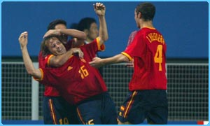 Spain celebrate as they win their group