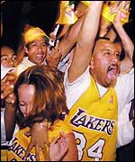 Fans of the LA Lakers celebrate their 'three-peat'