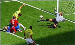 Costa Rica's Luis Marin opens the scoring by putting the ball into his own net