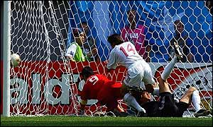 Hakan Sukur (left) bundles the ball over the line for Turkey's second goal